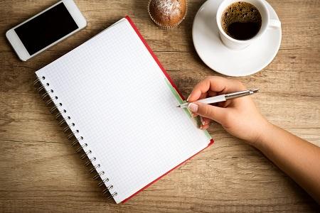 Making notes on coffee break – Thriving Under Pressure